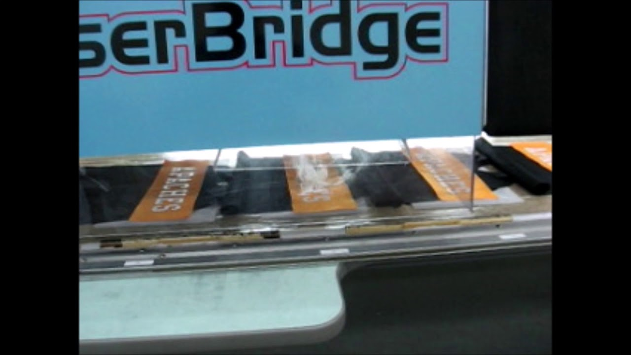 APACHE LaserBridge in Production Laser Cutting 7 letters individually on multi head embroidery machine
