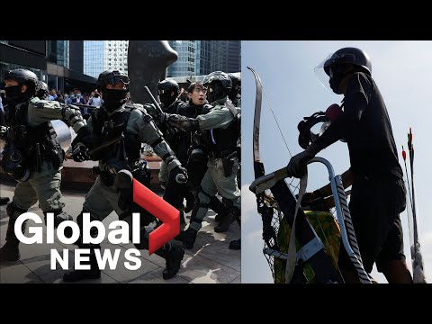 Hong Kong police patrol city in armoured vehicles, a day after protesters use homemade weapons