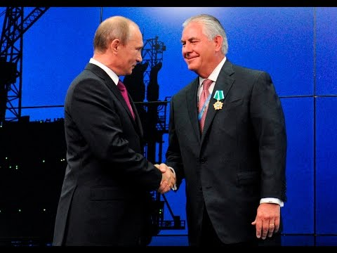 Here's Vladimir Putin honoring Rex Tillerson with a Russian friendship award.