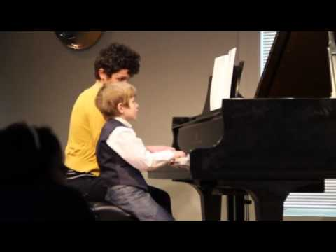 Amy & student play Showboat (Faber) at the 2015 winter recital in Ann Arbor, Michigan.