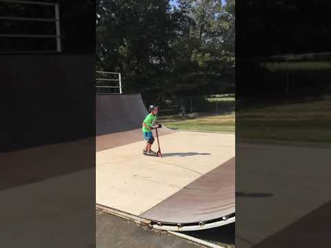 Dardanelle Skate Park: 9 year-old scooter rider on the half pipe.
