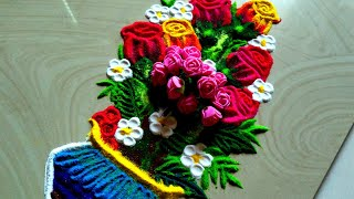 Beautiful and attractive rose flowers Rangoli using spoon and pen