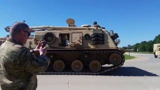 US army tank tearing up the street