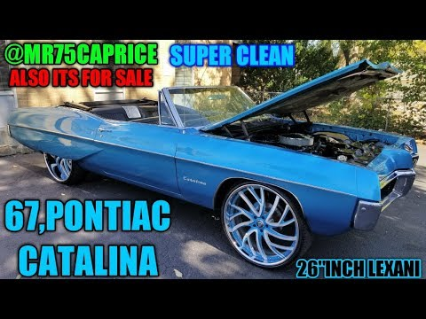67 PONTIAC CATALINA ON 26 INCH LEXANI ALSO NEW WHEELS AND SHIRTS FOR SHOP