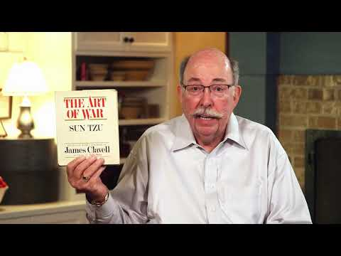 Jim Lara holds up The Art of War
