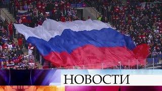 Хоккейные болельщики в предвкушении матча Россия - Финляндия.