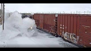 Train Plows Through Snow Drift