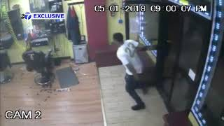 Video shows shooting during barbershop robbery