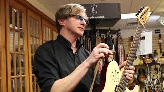 How to adjust and attach a guitar strap by Levy's