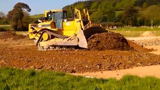 CAT D8 dozer at work pushing gravel for road construction