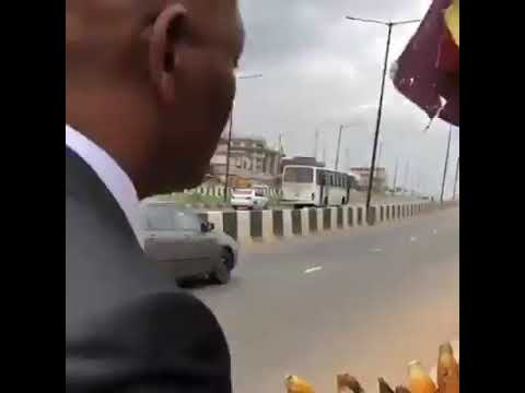 Nigerian Billionaire and CEO UBA Bank, Tony Elumelu stops by the road to buy roasted corn in Lagos