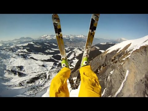 Skiers Escape Avalanche by Jumping off Cliff