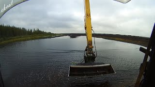 Demolition of two dams with a Long Arm Excavator