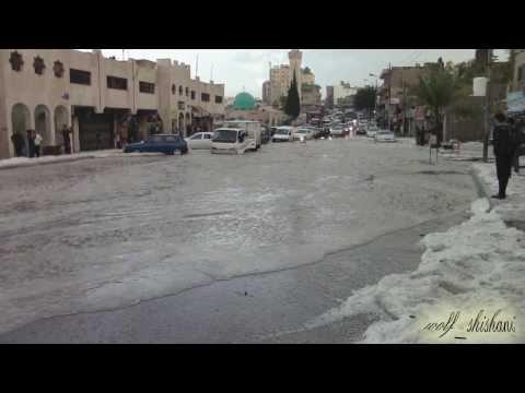 أكوام البرد في شوارع الأردن ,,بعد عاصفة البرد 1-11-2013