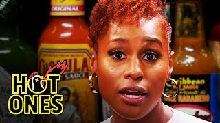 Hot Ones - Issa Rae Raps While Eating Spicy Wings