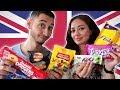 TRYING BRITISH CANDY & SNACKS TASTE TEST 🇬🇧 Jay & Rengin