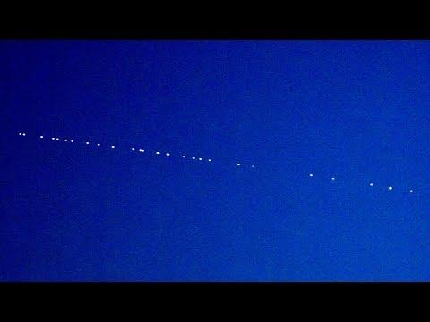 SpaceX Starlink satellite train at dusk