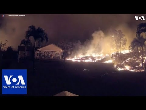 A time-lapse video of lava flowing towards house in Hawaii