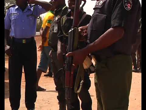 Nigeria Police parades highway robbers in military camouflage