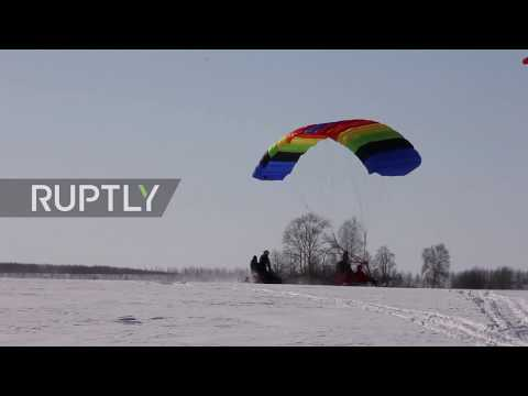 Russian daredevil flies hang-glider to polling station to vote in presidential election