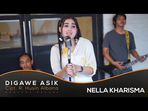 , title : 'Nella Kharisma - Digawe Asik (Official Music Video)'
