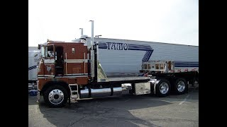 Walk-Around Of A 1984 Freightliner Cab-Over With A Stepdeck Trailer