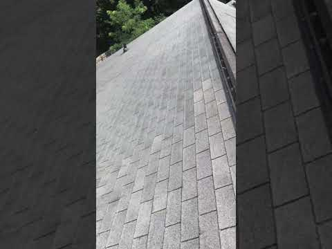 This family has an older 3-tab roof with fiberglass showing all over.  Our experts inspect the roof.