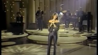 "Crystal Gayle singing ""Don't It Make My Brown Eyes Blue"" in black spandex disco pants"