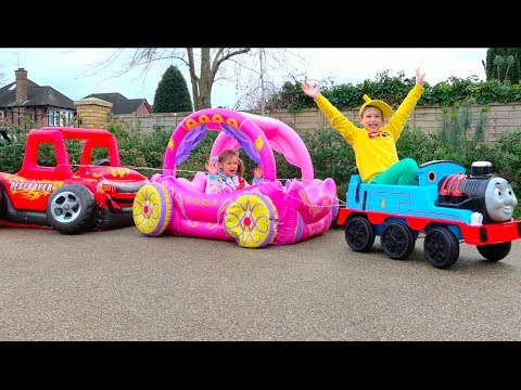 Max and Katy playing with Ride-on Toy Cars