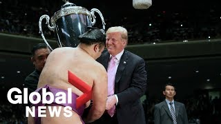 Trump becomes 1st U.S. president to watch sumo in Japan