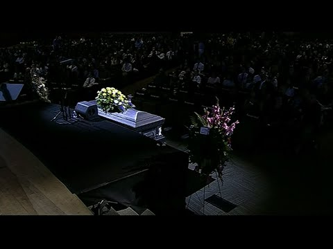 About 2,000 people filled a large church in suburban Denver to honor a student killed while trying to stop one of two gunmen at his Colorado school. (May 15)