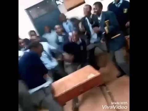 Kenyan high school boys dancing in class