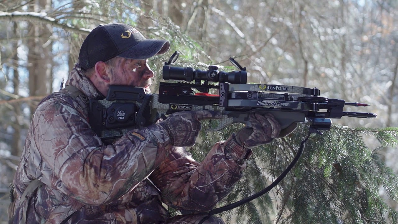 """Cemented at the top of the food chain, the Nitro XRT is fueled by RX7 cams™ and our Vector Quad™ 4 cable system that generate unprecedented power and nock-breaking accuracy. Its center-mounted riser eliminates the """"nose-heavy"""" feel of traditional crossbows and produces the smoothest shot on the market. Effortlessly draw the crossbow with the silent ACUdraw PRO and become a sniper in the woods with the EVO-X Marksman Scope."""