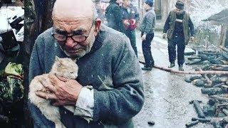 Elderly Man Hugs Cat After His House Burns Down In Turkey, Now Has A Safe And Warm Place!