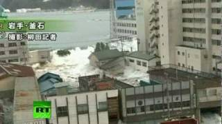 Fresh footage of huge tsunami waves smashing town in Japan