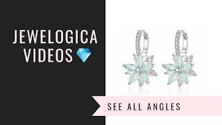 Double flower earrings plated in White Gold with CZ