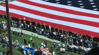 Eagles link arms during The Star Spangled Banner