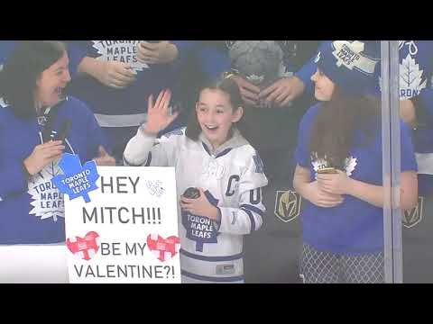 Maple Leafs player Mitch Marner makes a young fan's year after throwing her a puck and agreeing to be her valentine