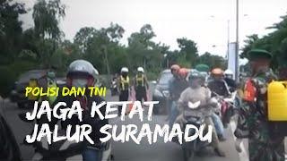 Jalur Suramadu Dijaga Ketat, Polisi dan TNI Pindai Suhu Tubuh dan Semprotkan Disinfektan