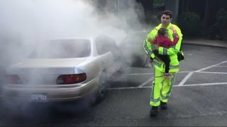 Watch This Officer Pull Two Babies from a Burning Car
