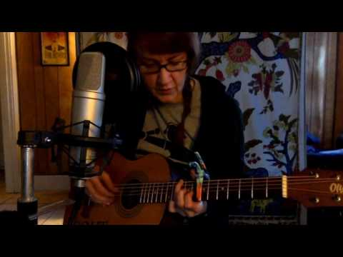 Lee plays Scarborough Fair on acoustic guitar