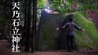 Three megaliths are enshrined Deity. Worshiping a rural shinto shrine of japan.