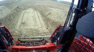 Kubota svl75 leveling sand