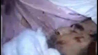فيديو مسرب  لجنازة #صدام_حسين - كشف الكفن واظهار وجهه ( الله يرحمه )