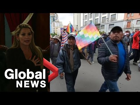 Bolivia's interim president sworn in as Morales supporters march in streets