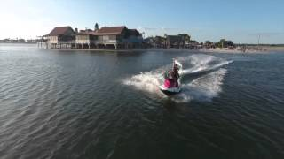Riding Jetski at Whiskey Joes beach  recorded with flying drone in  Tampa Florida