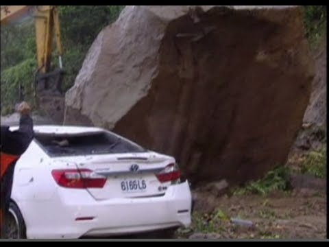 Driver's Remarkable Escape From Giant Boulder