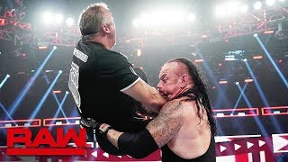The Undertaker comes to Roman Reigns