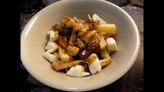 Canadian Poutine: French Fries With Squeaky Cheese And Gravy