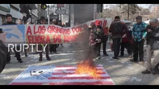 Chile: Protesters set fire to US flags upon Pence